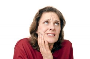 8639758 - woman with toothaches holding her jaw